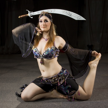 beautiful woman dancing the oriental style dance called belly dance Stock Photo - 9176957