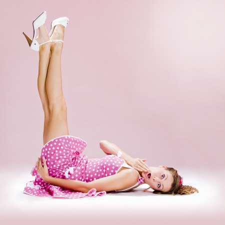 happines: a beautiful inocent pin-up girl over a pink background