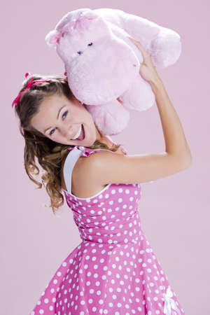 inocent: a beautiful inocent pin-up girl over a pink background