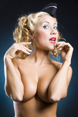 funny pin-up soldier sexy woman in topless over a dark blue background