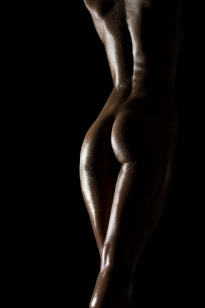 anatomy nude: sexy female body shapes and curves over a dark background