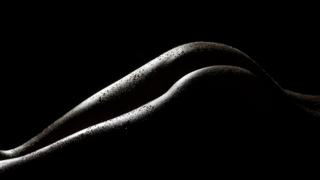 nude black women: sexy female body shapes and curves over a dark background