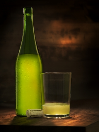 bubble acid: nice bottle and glass of natural and organic cider Stock Photo