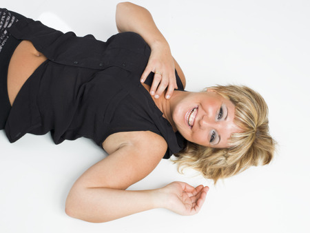 real middle aged woman laying on white floor