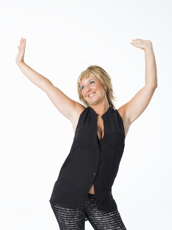 aged: real middle aged woman posing on white background Stock Photo