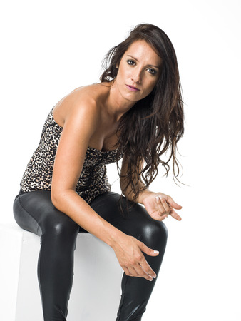 sexy rude woman in leather trousers posing Stock Photo