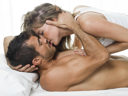 foreplay sex: a man and a woman foreplaying in a white background