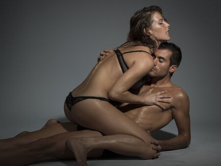 erotic couple: erotic scene of a sexy man and woman making love