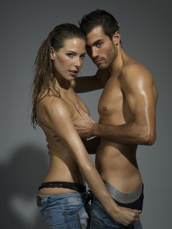 man and woman sex: a man and a woman foreplaying in grey blackground