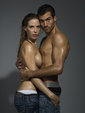 wet breast: a man and a woman foreplaying in grey blackground
