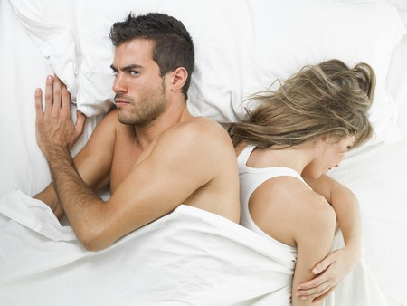 communicative: non communicative offended couple goes to sleep unhappy Stock Photo