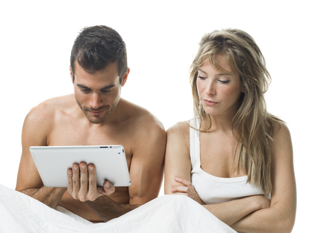 offend: angry woman while his partner is watching a tablet