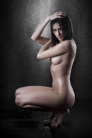 image of a sexy adult nude woman in provocative attitude under the water photo