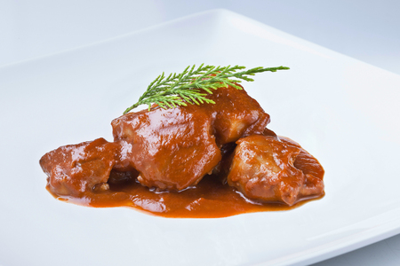 traditional recipe from spain with sauce called manitas de cerdo