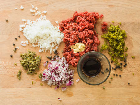 gastro: preparing a delicious raw meat dish in a restaurant