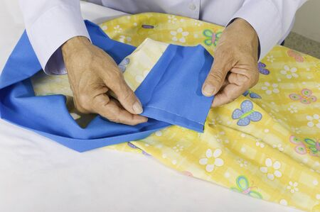pillow case: A woman turns pillow case right side out and shows finished seams, no raw edges.