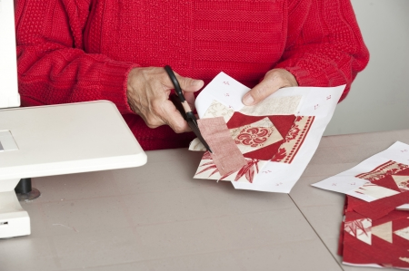 off cuts: A quilter cuts off excess material for accurate seam allowance