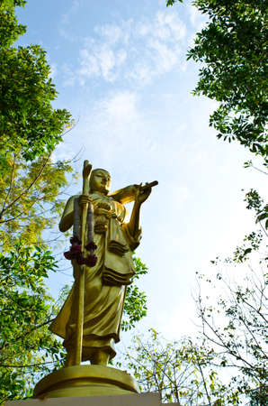 The Buddha statue among the forest, Thailand
