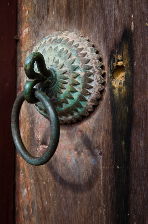 Handle of the very old temple door,Thailand photo
