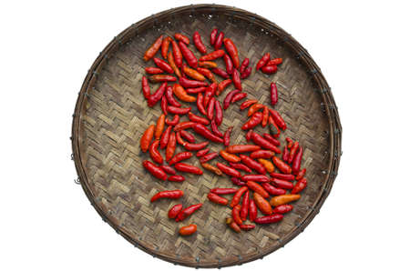 Thai red chili in old bamboo tray Stock Photo - 12755723