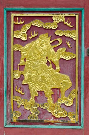 Carving art on the old chinese temple door  photo