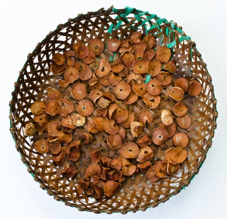 Dry betel nuts on bamboo tray