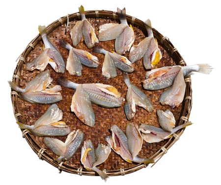 Dry fish on bamboo tray in direct sunlight Stock Photo - 13976757
