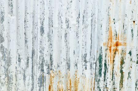 Closeup rusty old white zinc plate fence