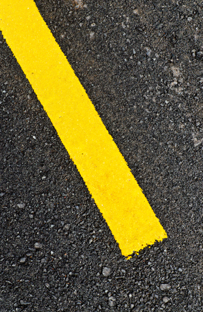 Closeup to asphalt road with the yellow line for background Stock Photo
