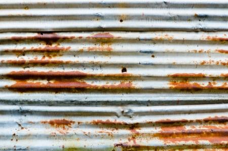 Rusty and damage zinc wall Stock Photo
