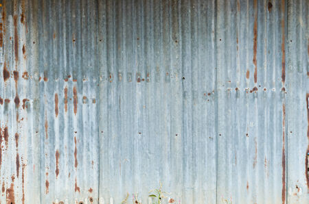 corrugated iron: Old damage rusty zinc plat wall