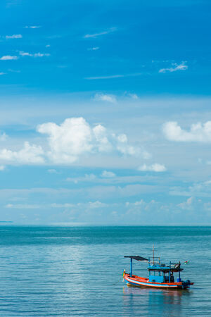 Small boat with blue sky Stock Photo