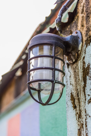 Old rusty wall lamp Stock Photo