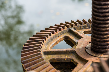 Old rusty and dirty steel gear closeup Stock Photo