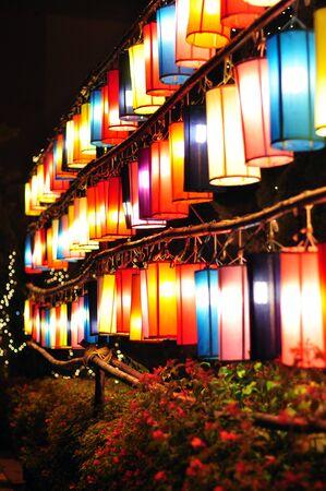 colorful lantern: many colorful lantern are hanging on rail  Stock Photo
