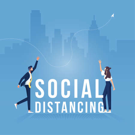 Two business people standing keep distance with the word social distancing in between