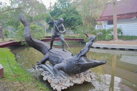 subdue: Krai Thong statue Samut Songkhram, Thailand: On January 29, 2017 Krai Thong  literature of the King Rama II. To subdue a crocodile