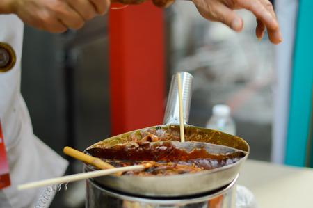 Rajadamri in Bangkok, Thailand: January 29, 2017 Chinese New Year, Shows Molding sugar from China