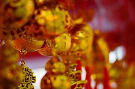 Chinese new year festival decorations, ang pow or red firecracker and gold ingots,items used in the belief that the good luck and wealth