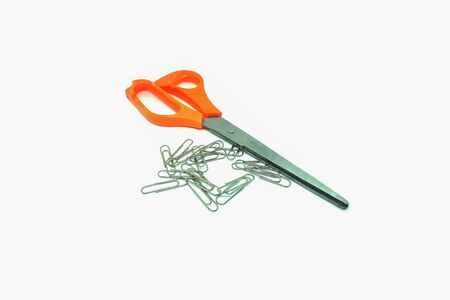 paperclips and  scissors on the white background,close up isolated Stock Photo