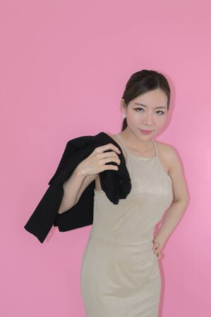 Side view of businesswoman  on pink background