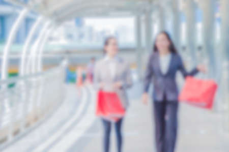 shopper: Blurred photo, Blurry image, businesswomen with shopping, background