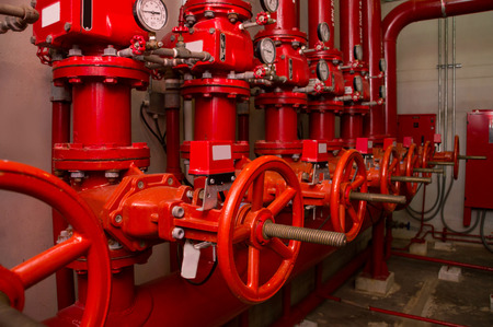 red generator pump for water sprinkler piping and fire alarm control system Standard-Bild