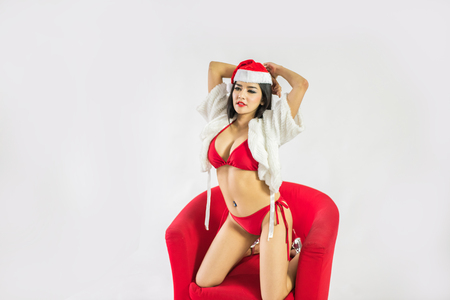 sexy asian woman: Beautiful happy woman in sexy Santa Claus clothes.