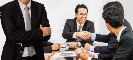 Half of the businessmen meeting for the planning meeting. Stock Photo