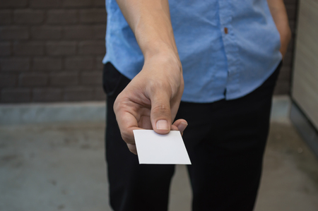 The young man took a blank card and handed it to him.