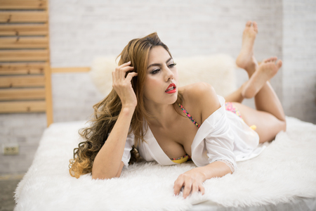 Sexy poses on a bed