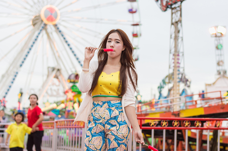 Beautiful women are happy in the amusement park. Stock Photo
