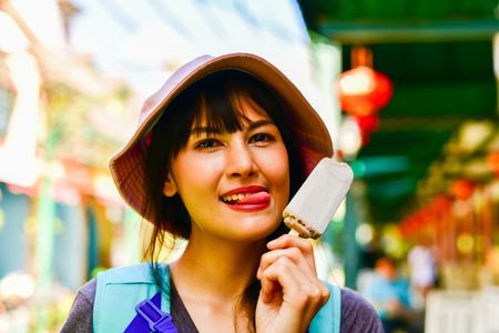 Beautiful women are eating delicious ice cream. Stock Photo