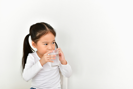 Girl wake up to drink water in the morning.